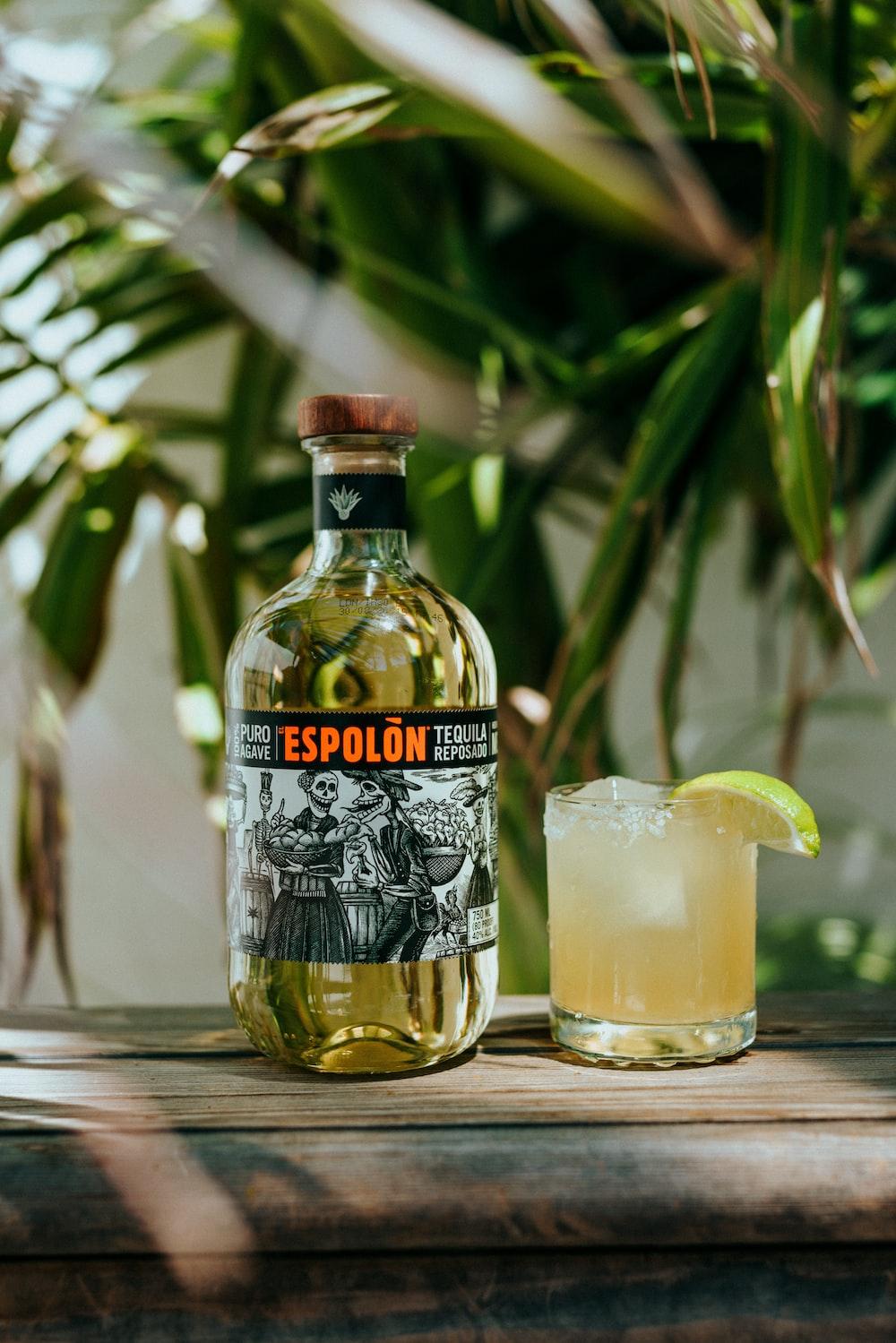 Espolòn Tequila bottle beside cocktail
