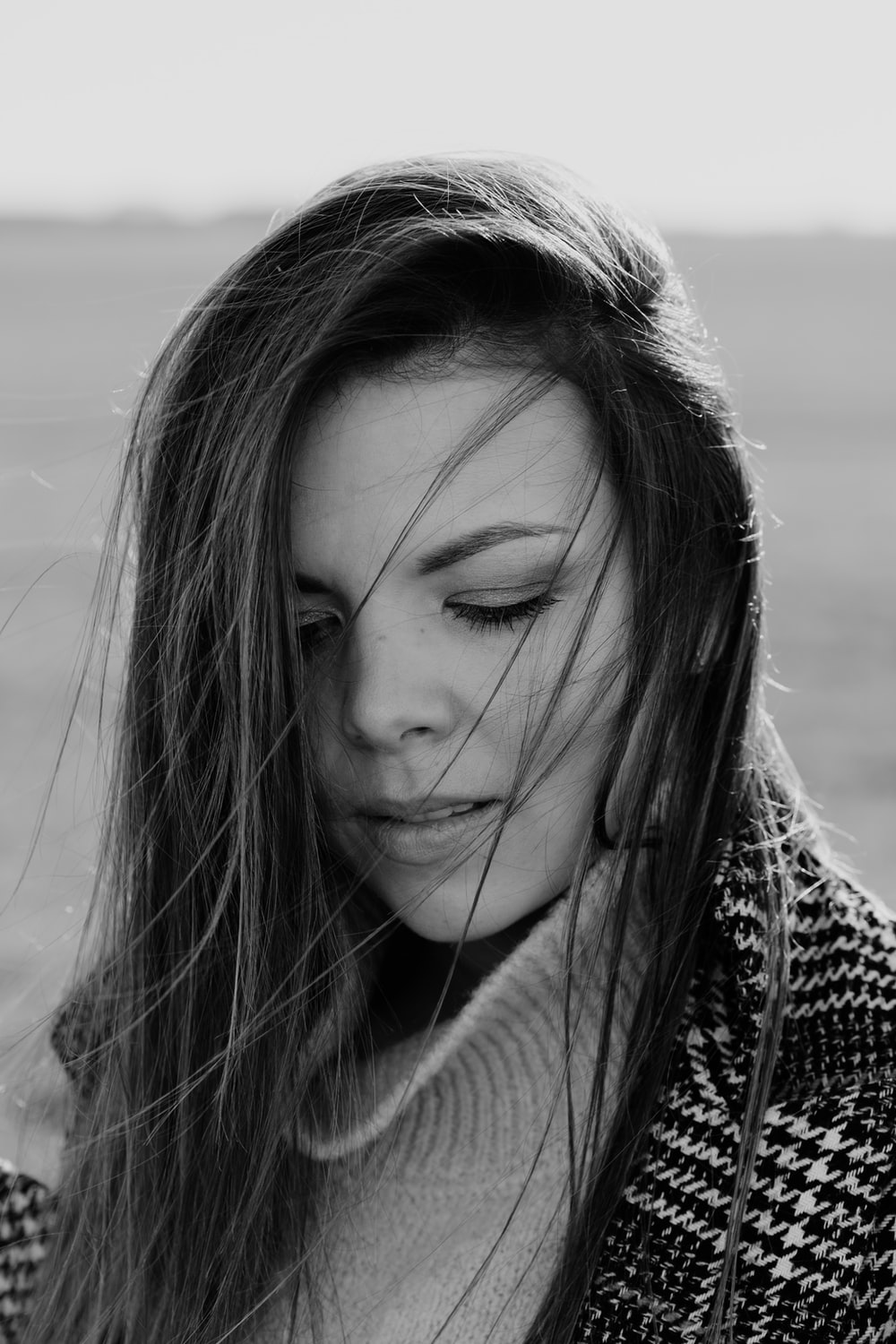 grayscale photo of woman in knit sweater