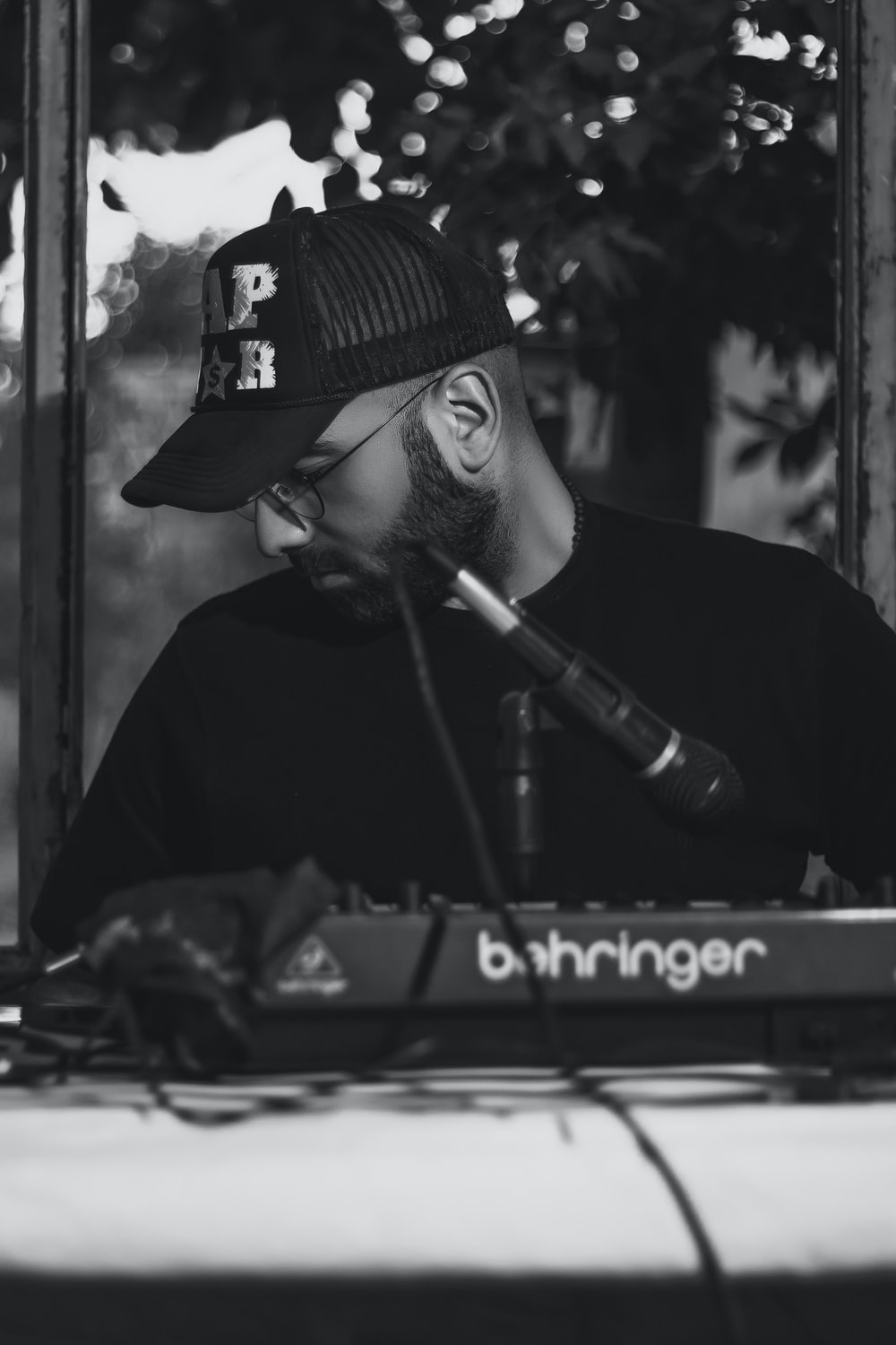 man in black hat playing piano