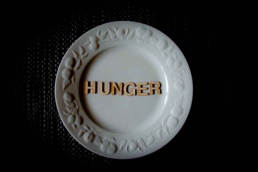 white and gold round ceramic plate