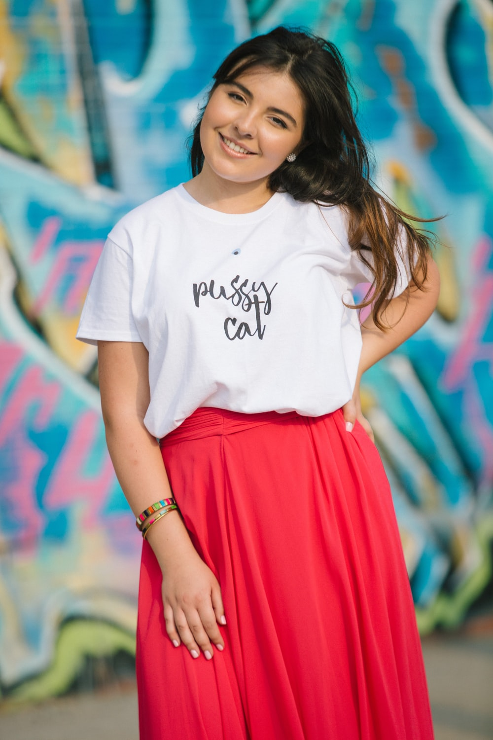 woman in white crew neck t-shirt and red skirt