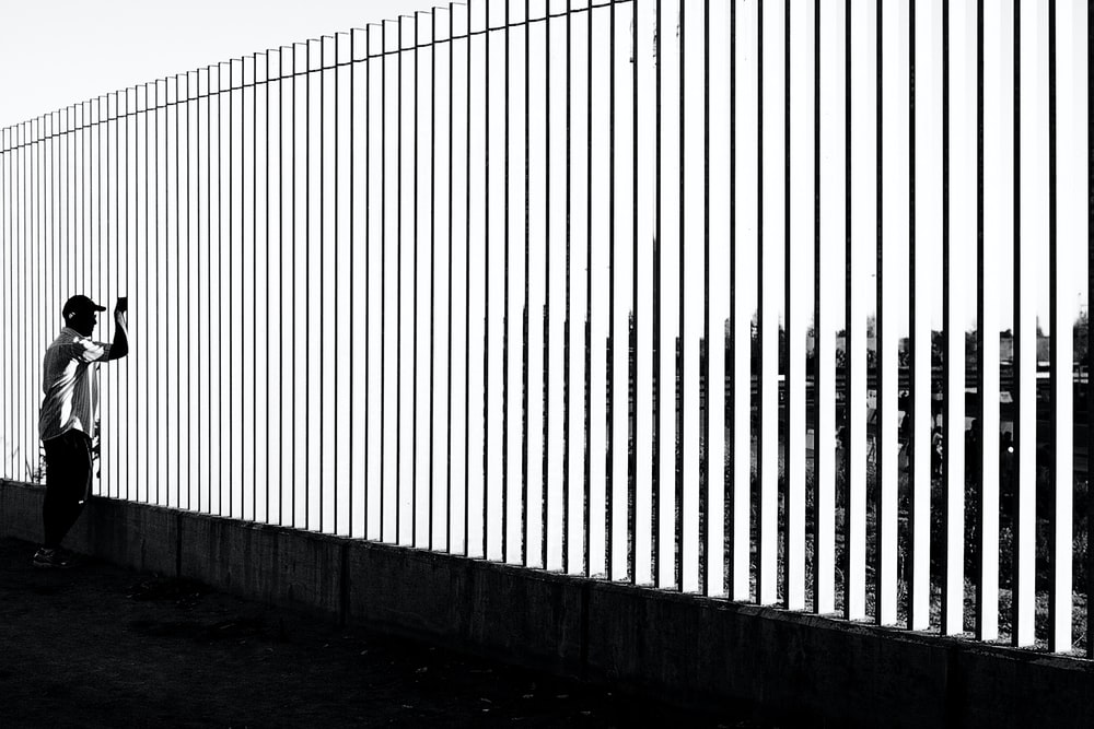 white and black wooden fence