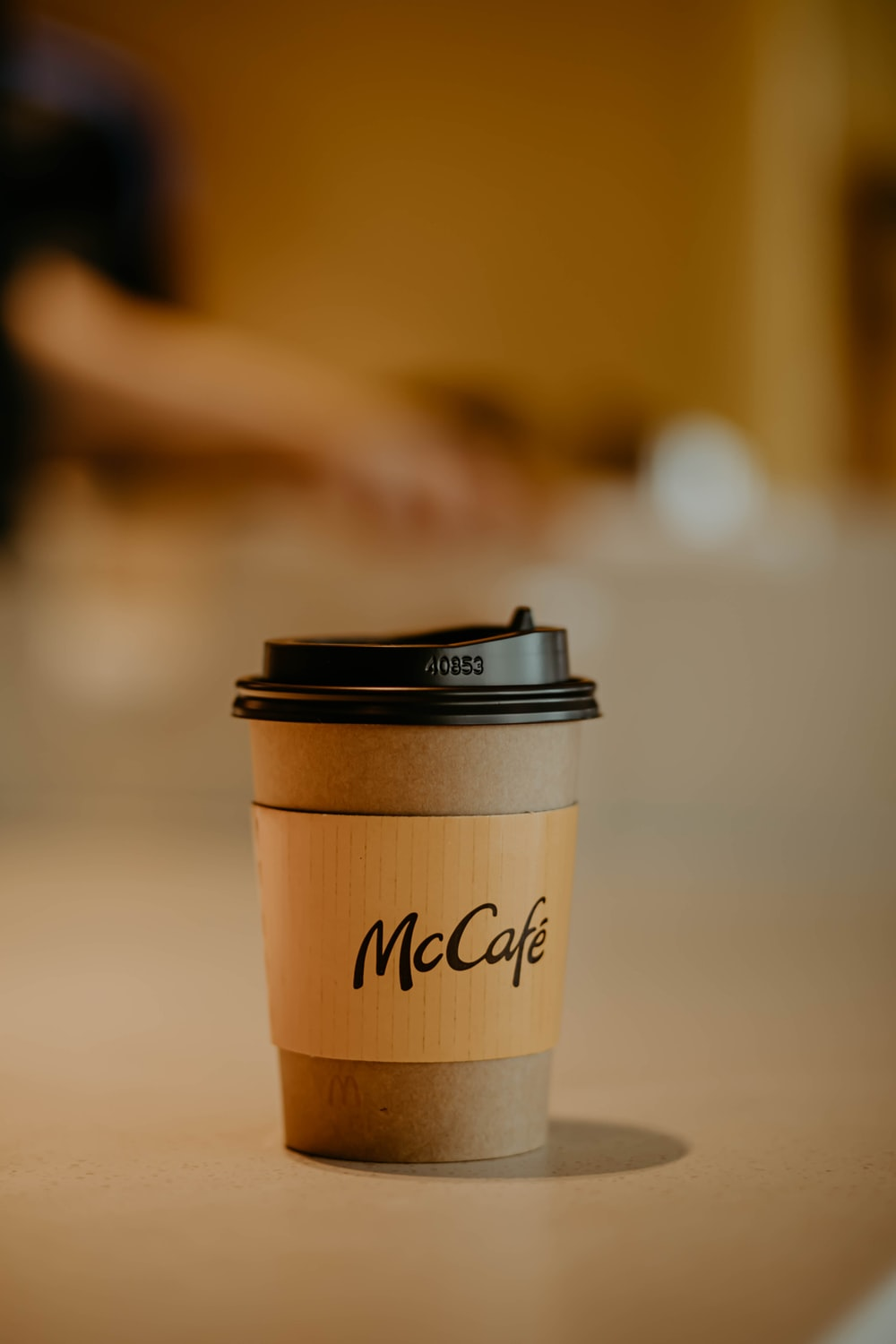 brown and black paper cup