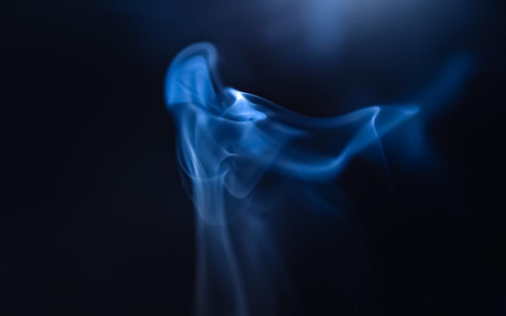 blue smoke in a dark room