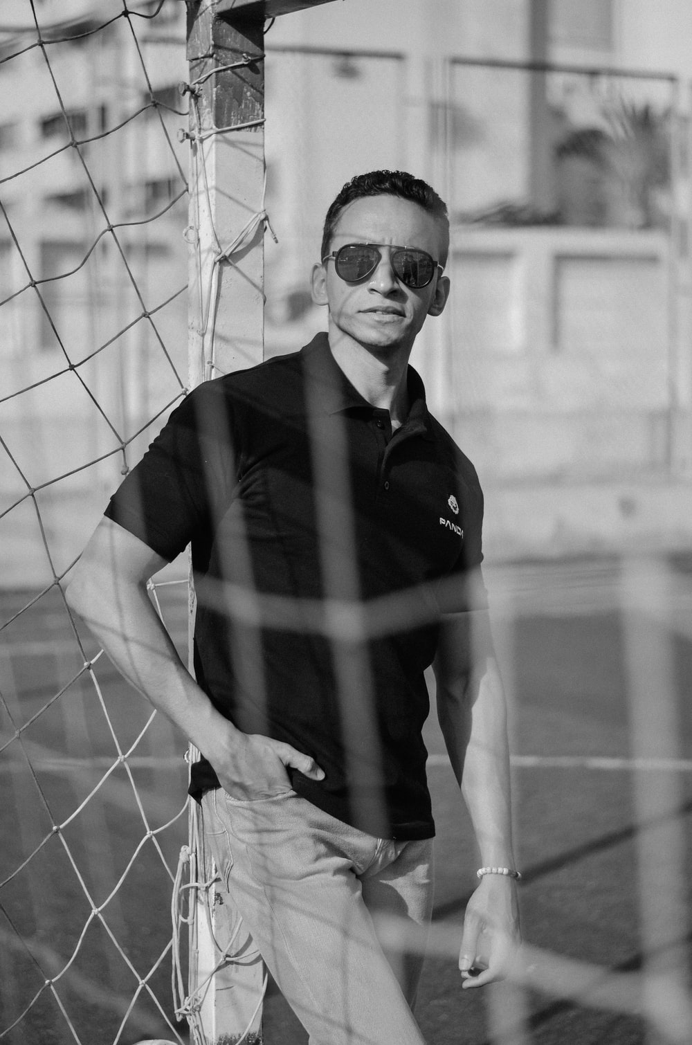 man in black polo shirt wearing sunglasses