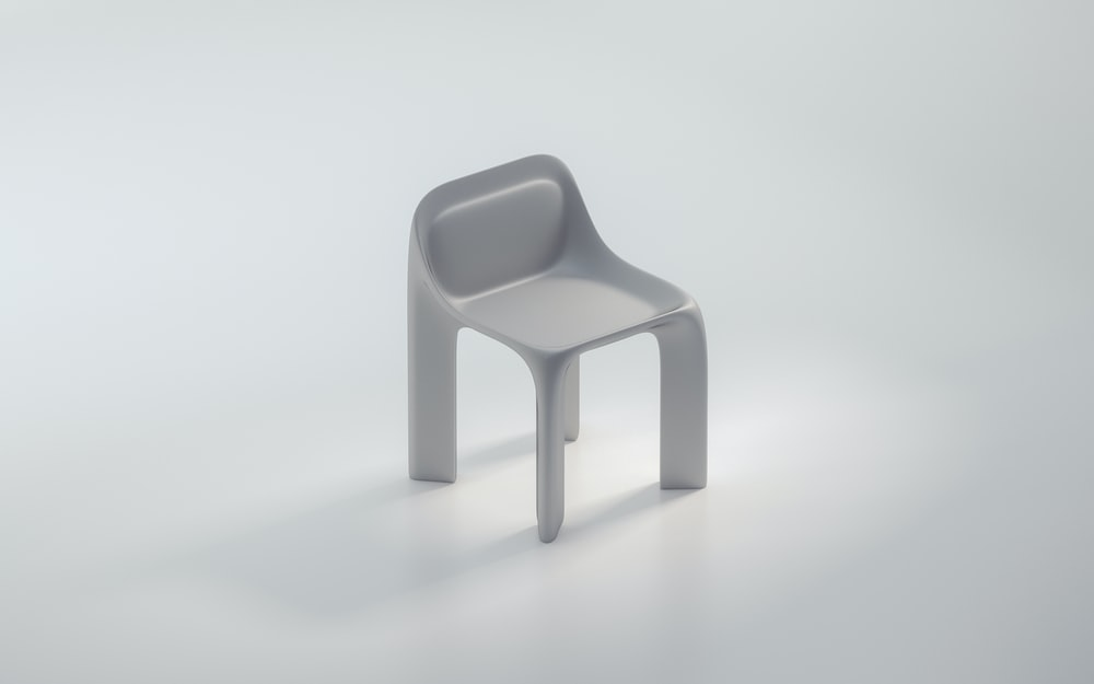white plastic chair on white surface