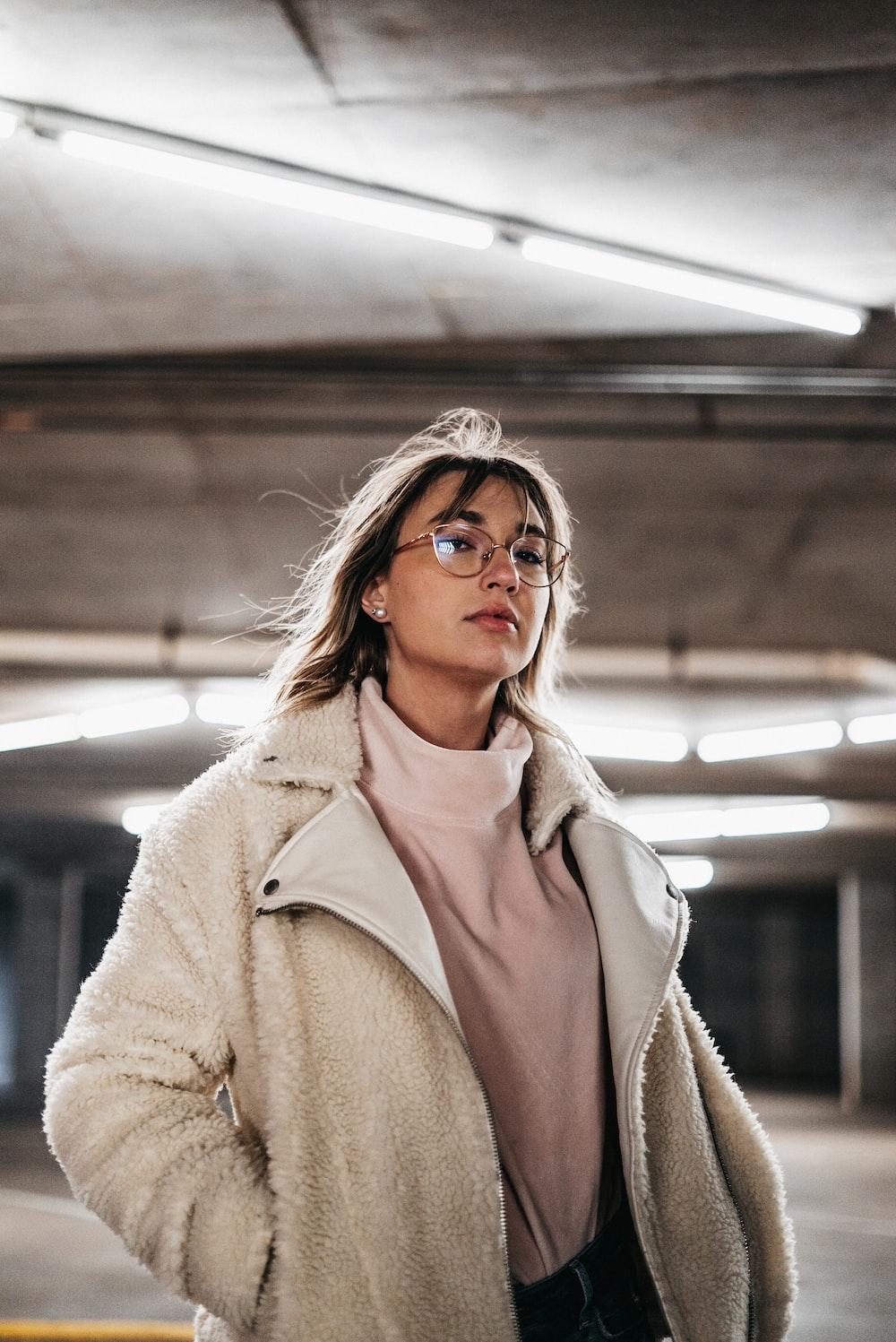 woman in brown coat wearing black framed eyeglasses