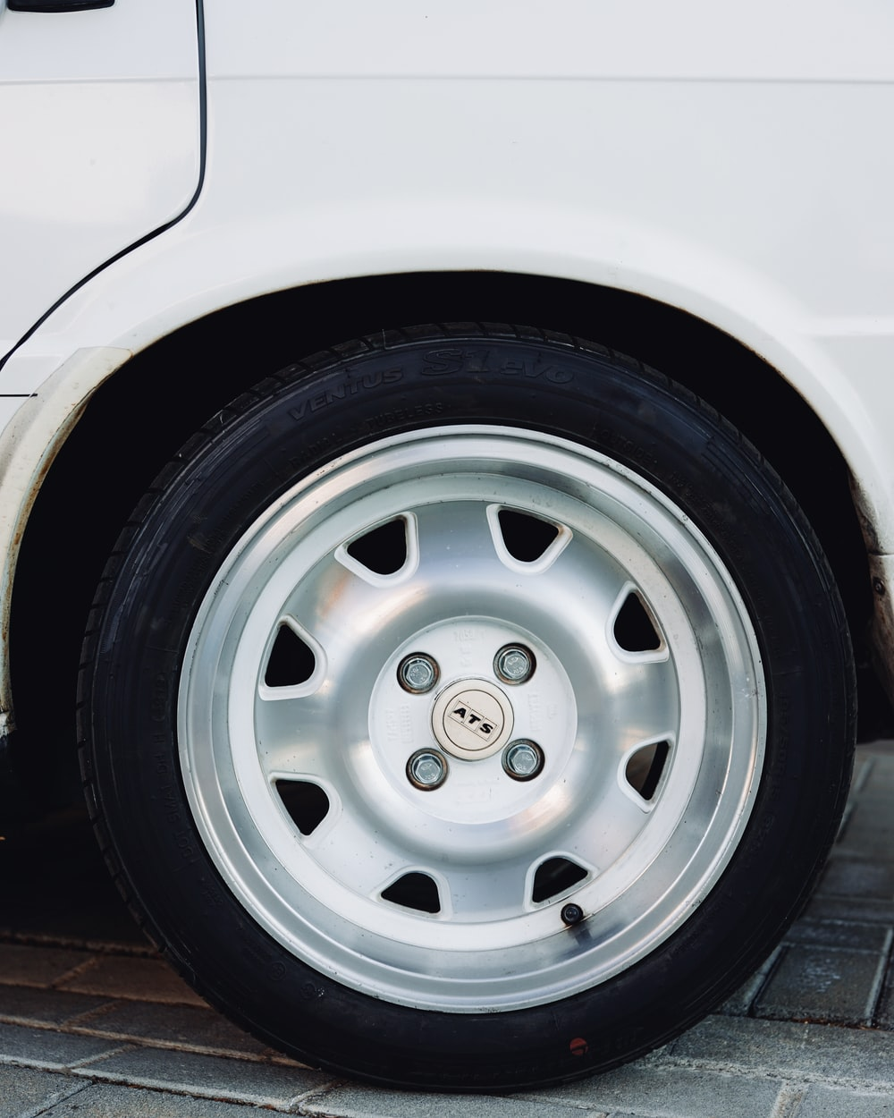 silver car wheel with tire