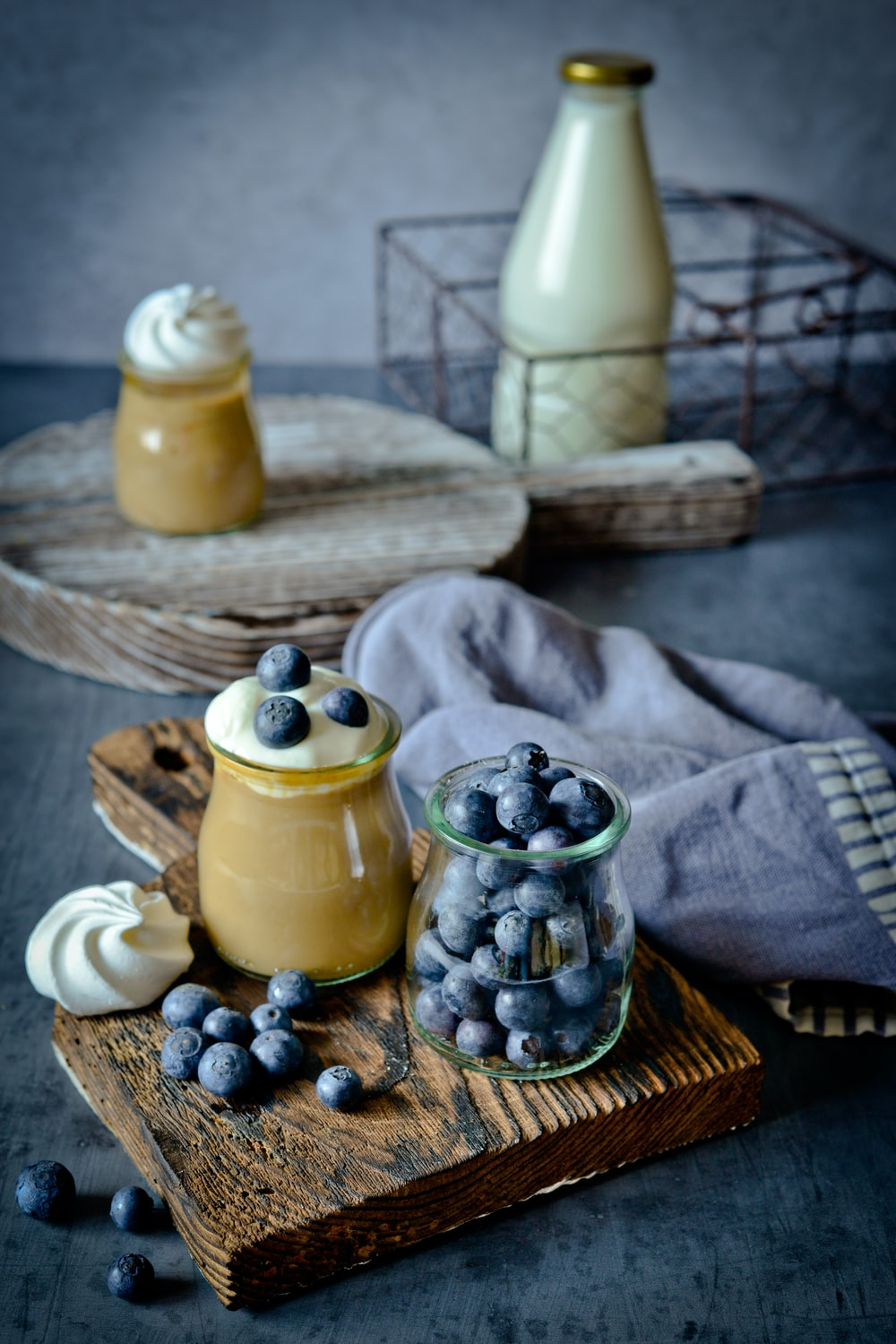 yellow ceramic jar on brown wooden table
