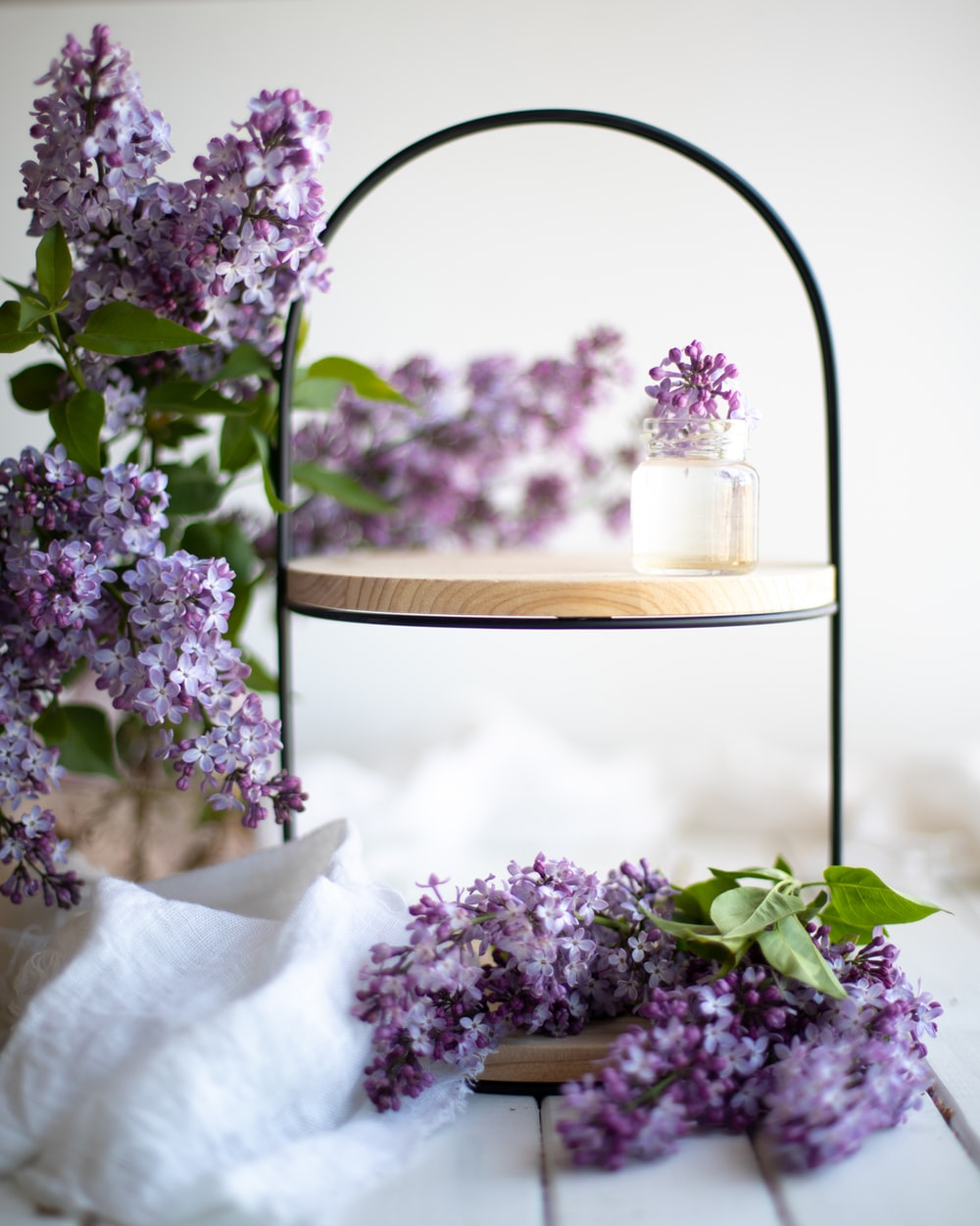 purple flowers on brown wooden round table