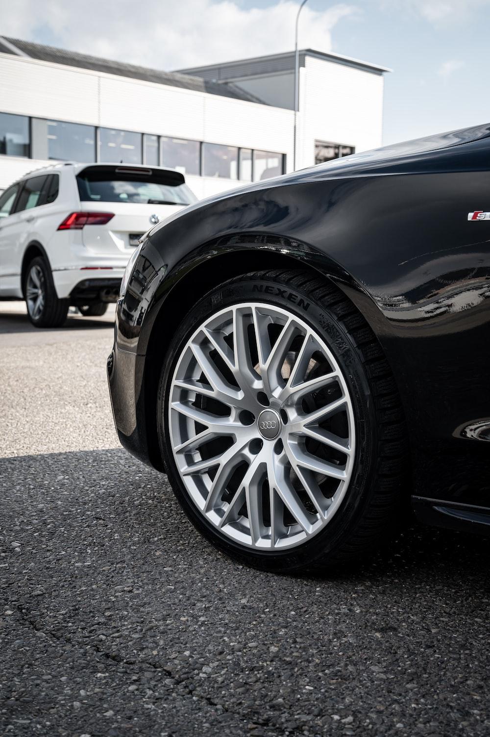 black car with silver wheel