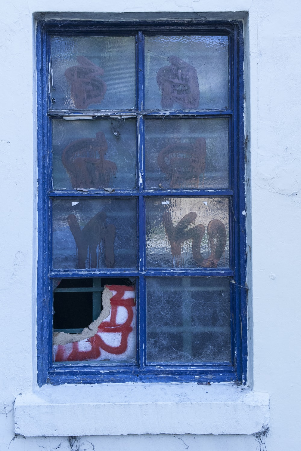 blue wooden window with red love print