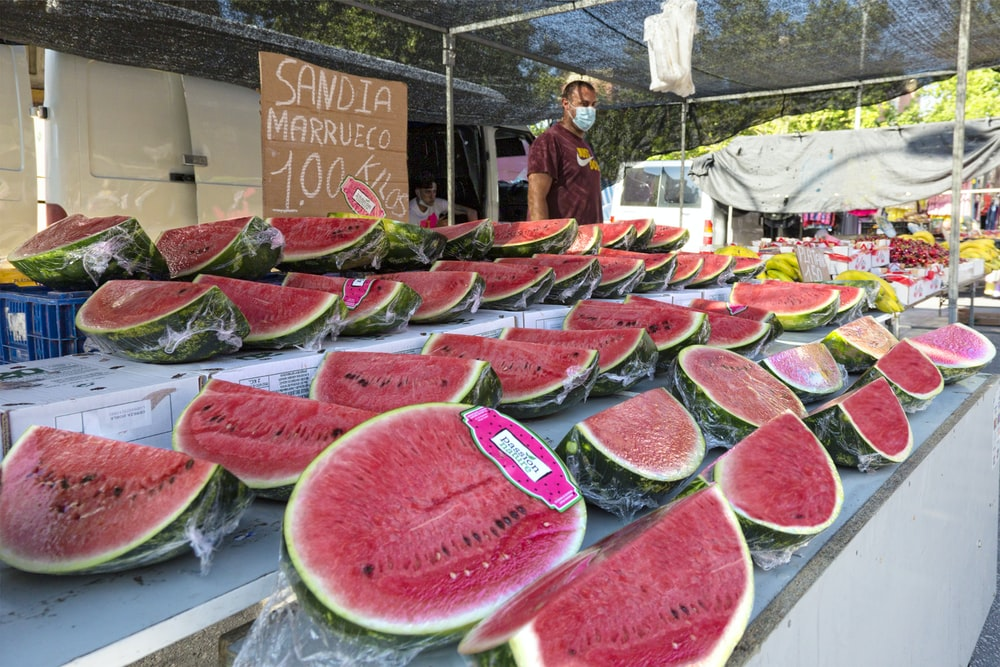 sliced watermelon on display during daytime