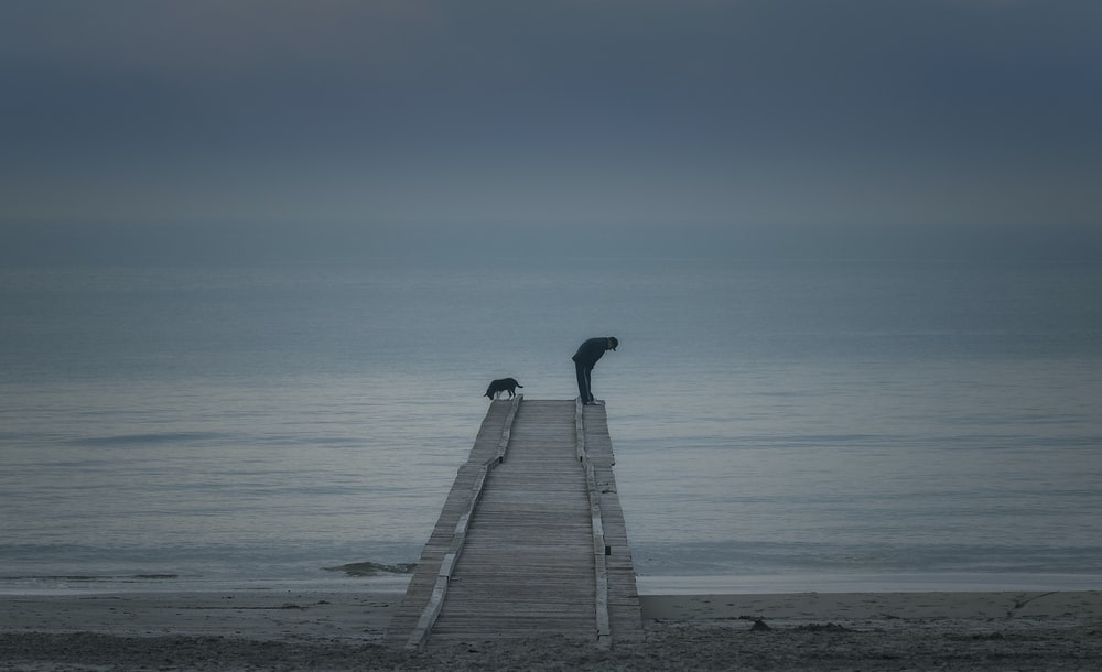 gray wooden dock on sea during daytime
