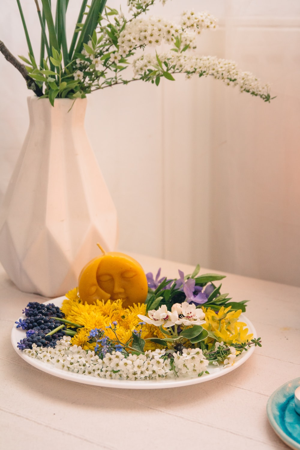 yellow and white flowers in white ceramic vase