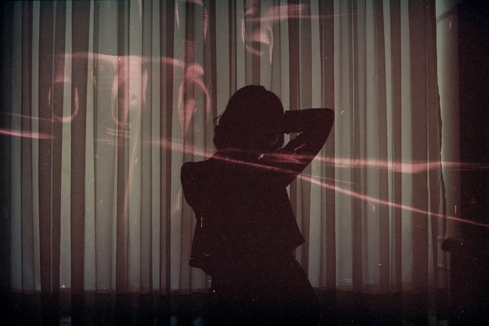 silhouette of woman sitting on chair