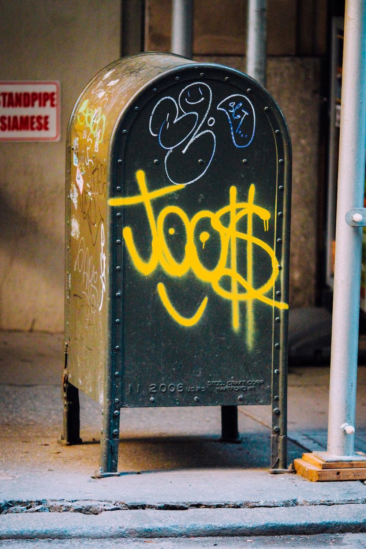 black and yellow metal mail box