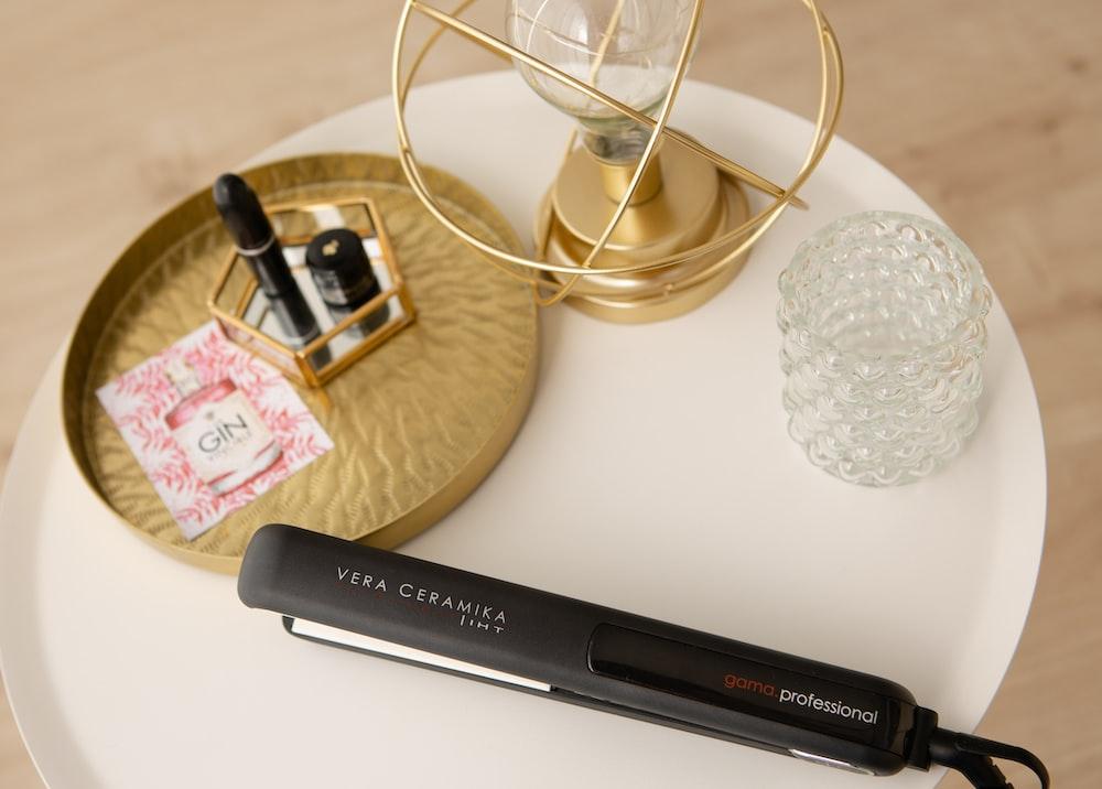 black and white pen on white table