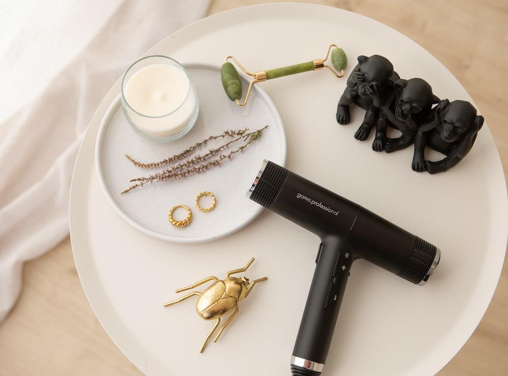 black hair dryer on white round ceramic plate