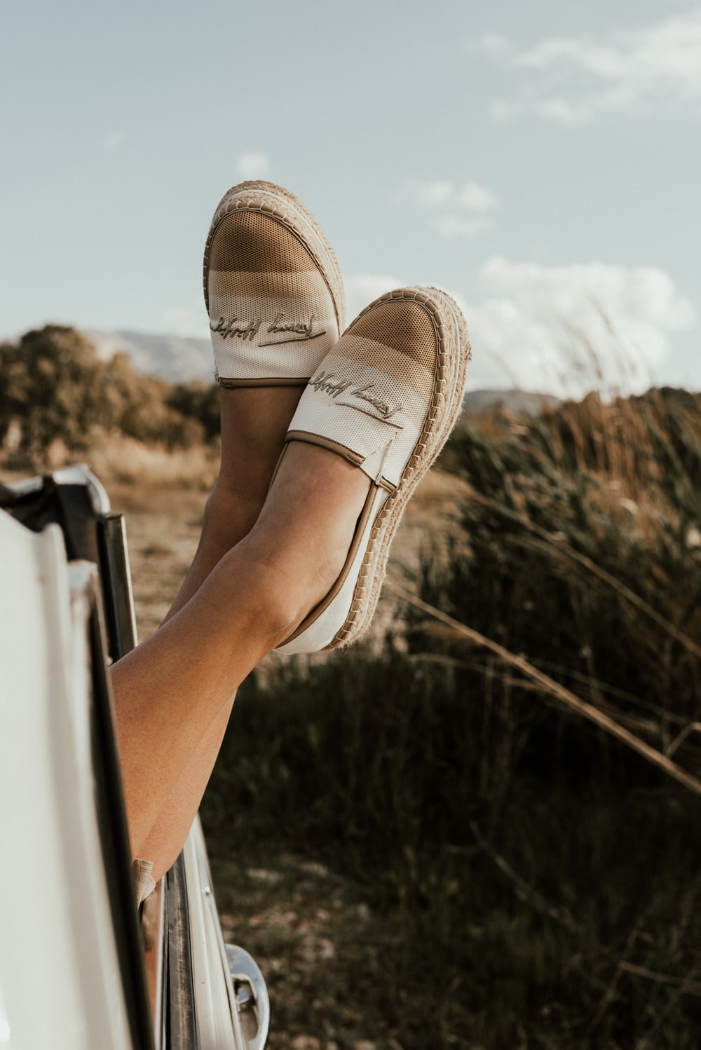 person wearing brown slip on shoes