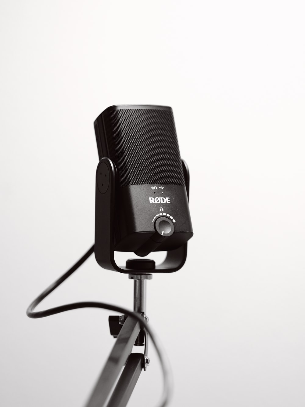 black and gray microphone on black microphone stand