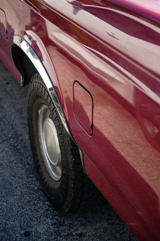 red car on gray asphalt road