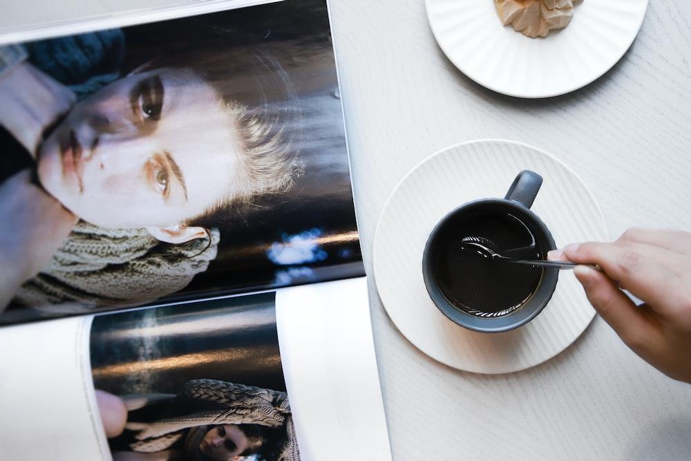 black ceramic mug on white round plate