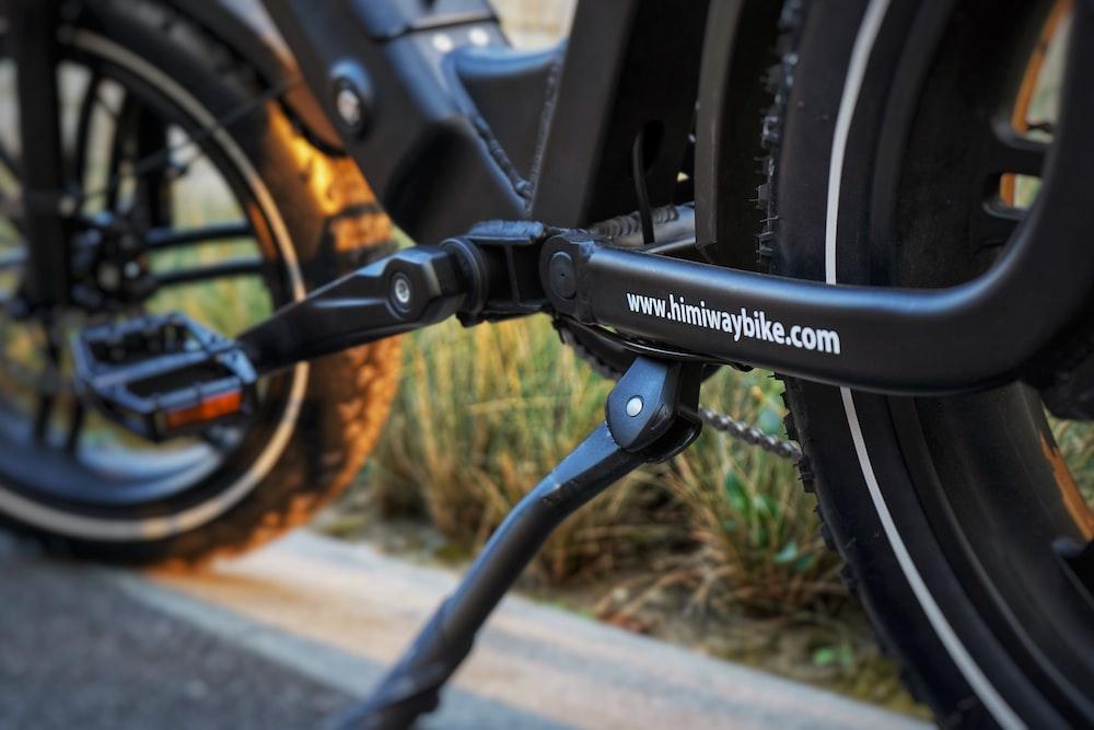 black bicycle wheel on brown concrete floor
