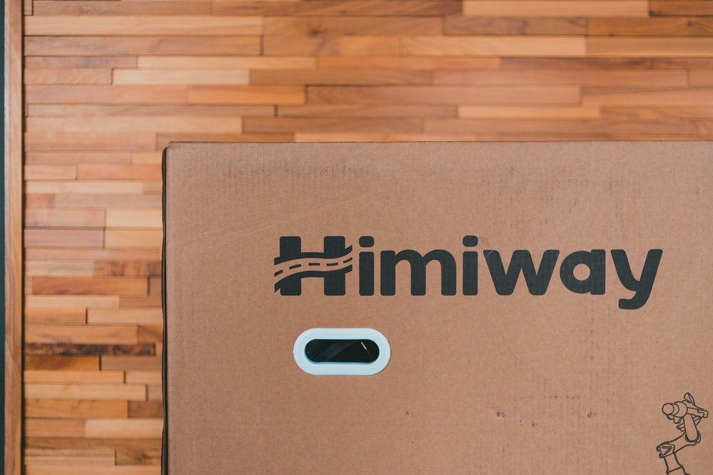 brown cardboard box on brown wooden floor