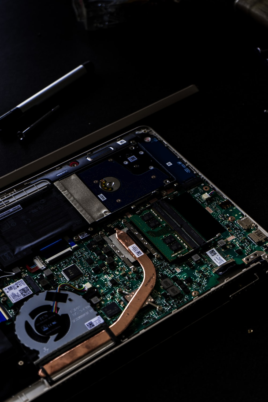 green and black computer hard disk drive