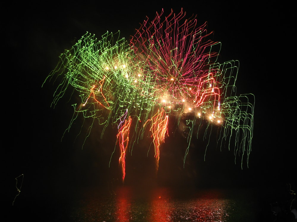 green and red fireworks display during nighttime