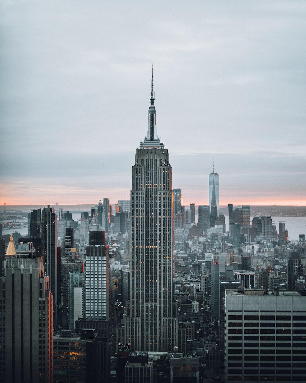 city skyline under orange sky