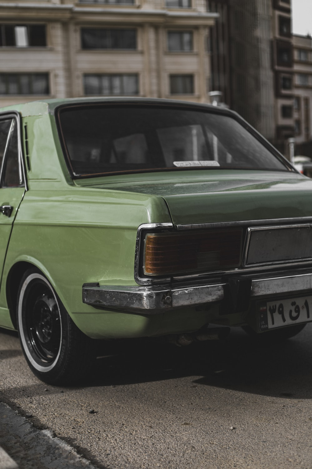 green and black classic car