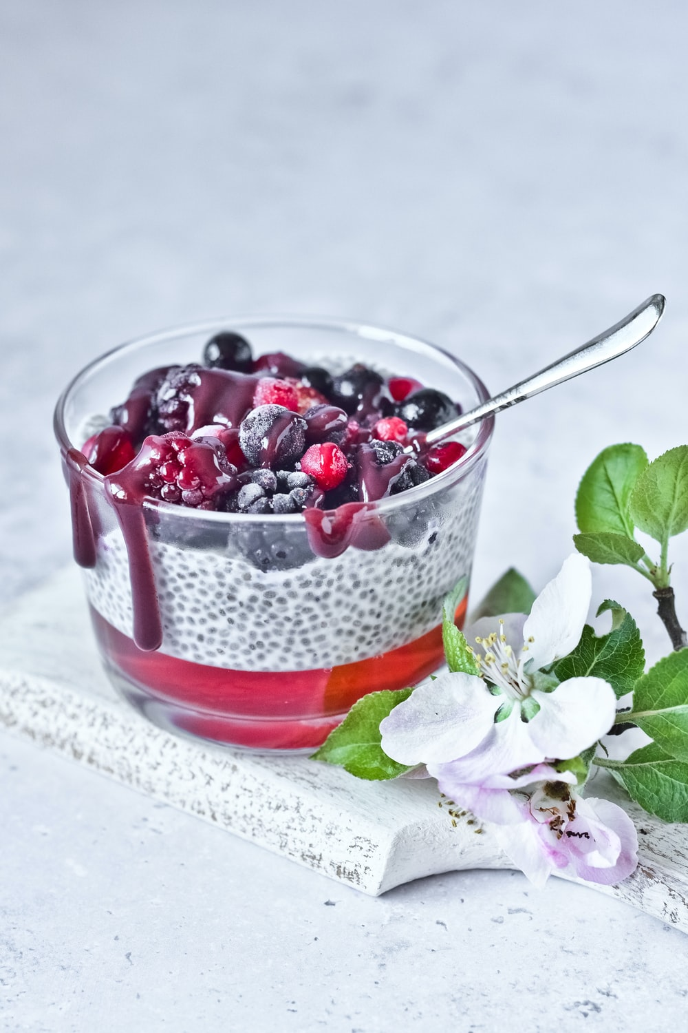 strawberry and blackberry in clear glass cup
