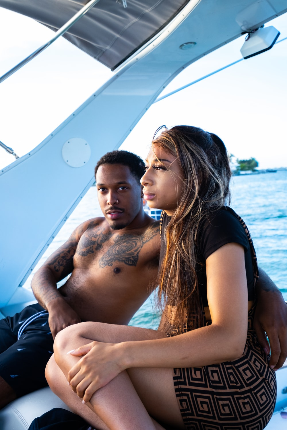 man and woman kissing on boat during daytime