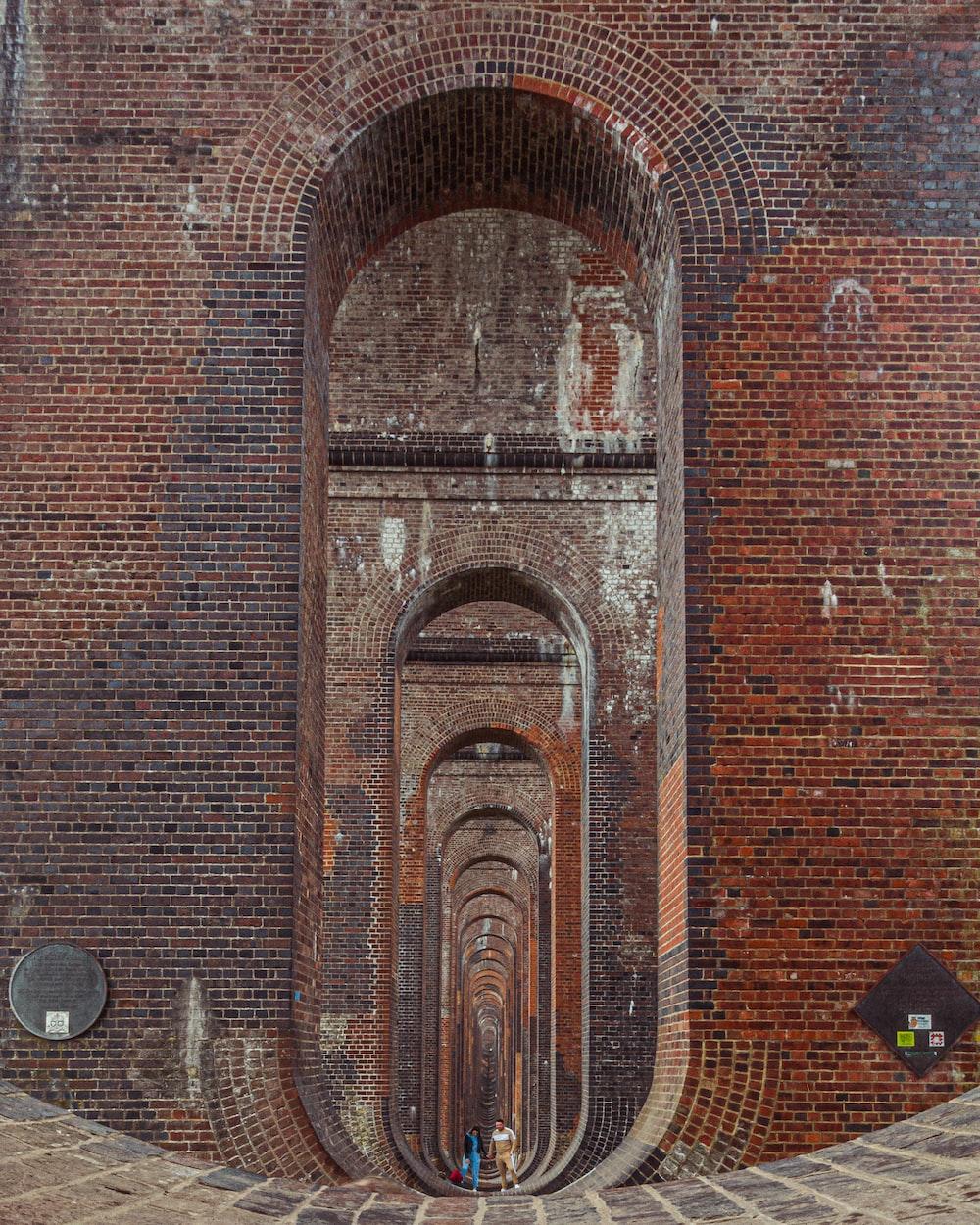 brown brick wall with brown brick wall
