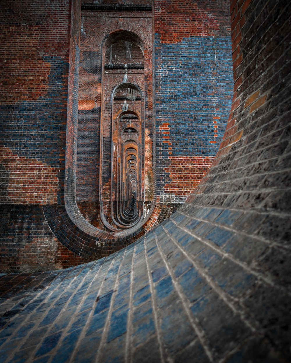 brown and gray brick tunnel