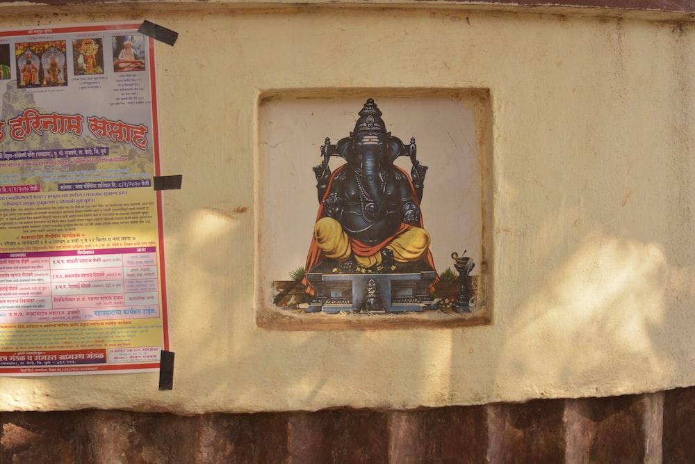 black and gold hindu deity figurine