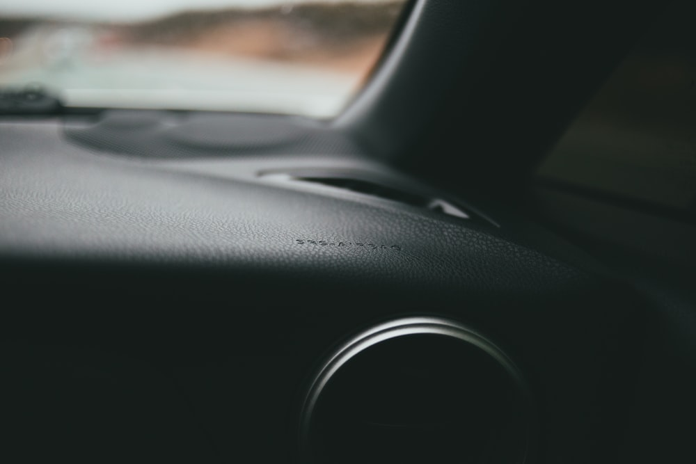 black car dashboard during daytime