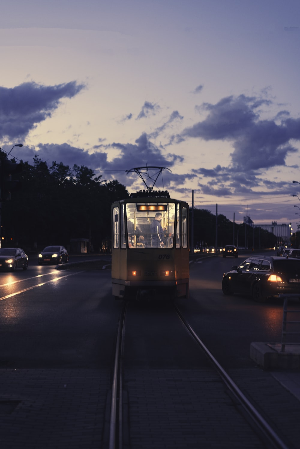 white and black tram on road during daytime