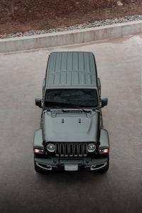black mercedes benz g class on gray concrete road