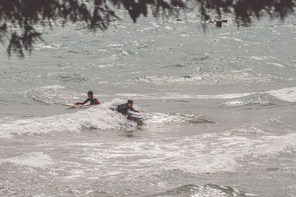 person surfing on water during daytime