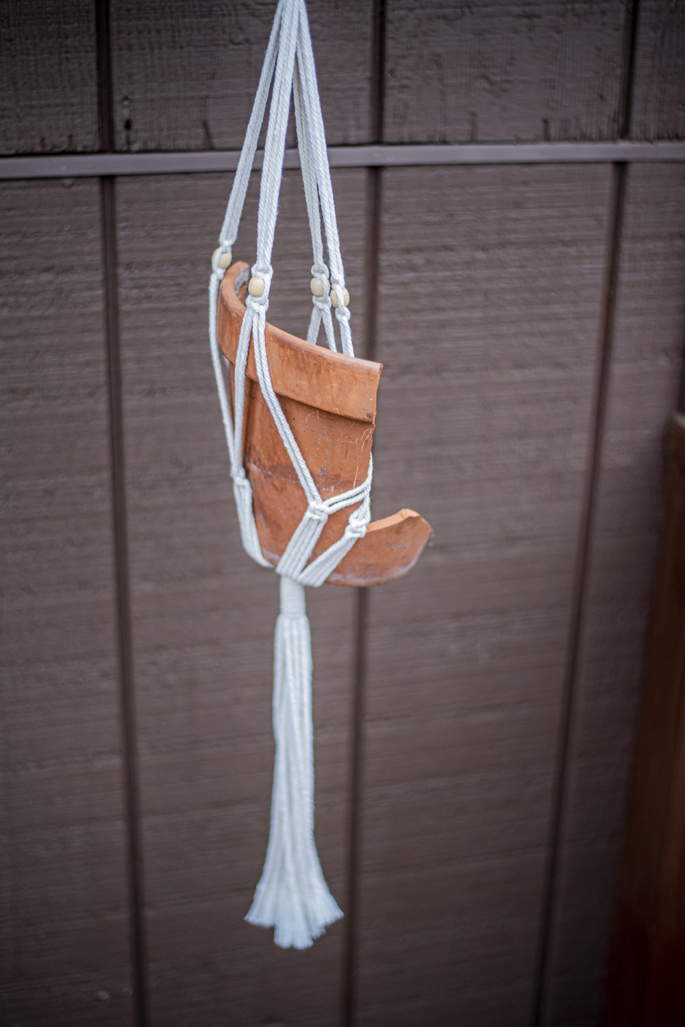 brown and white rope hanged on brown wooden wall