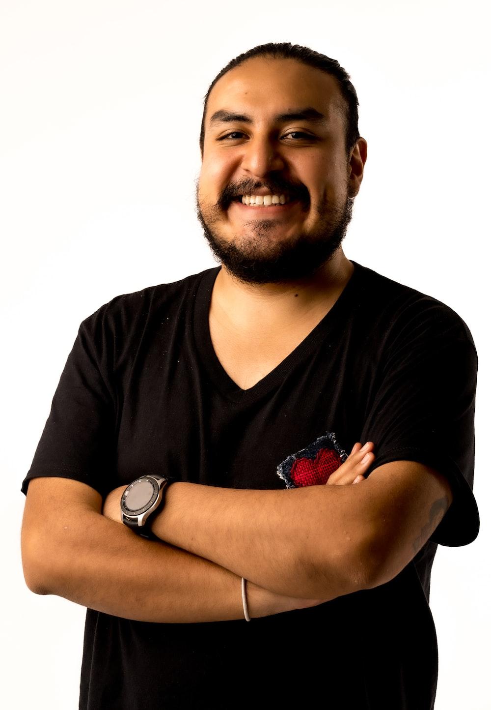 man in black crew neck t-shirt smiling