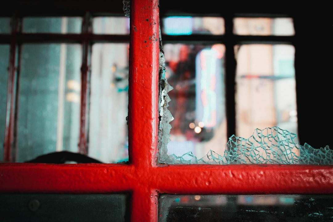 Red Wooden Framed Glass Window - unsplash