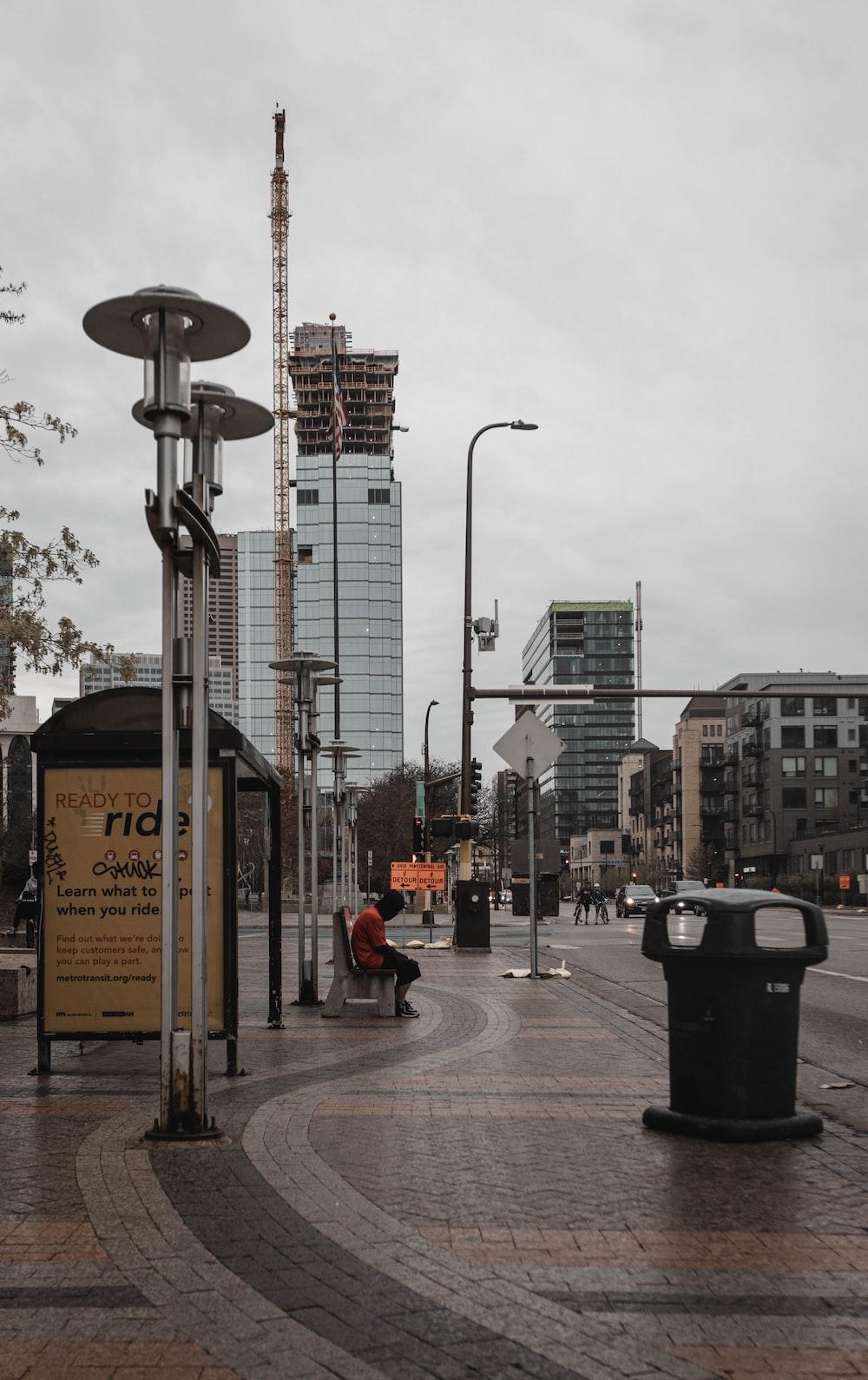 black street light near city buildings during daytime