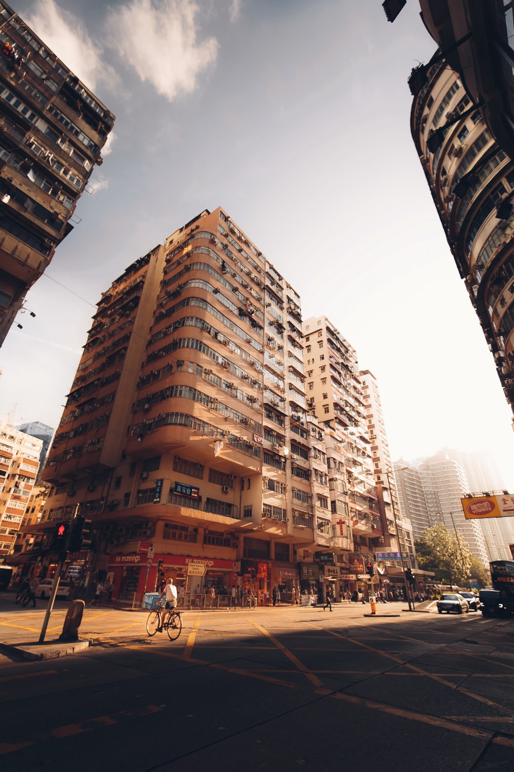 people walking on street near high rise buildings during daytime