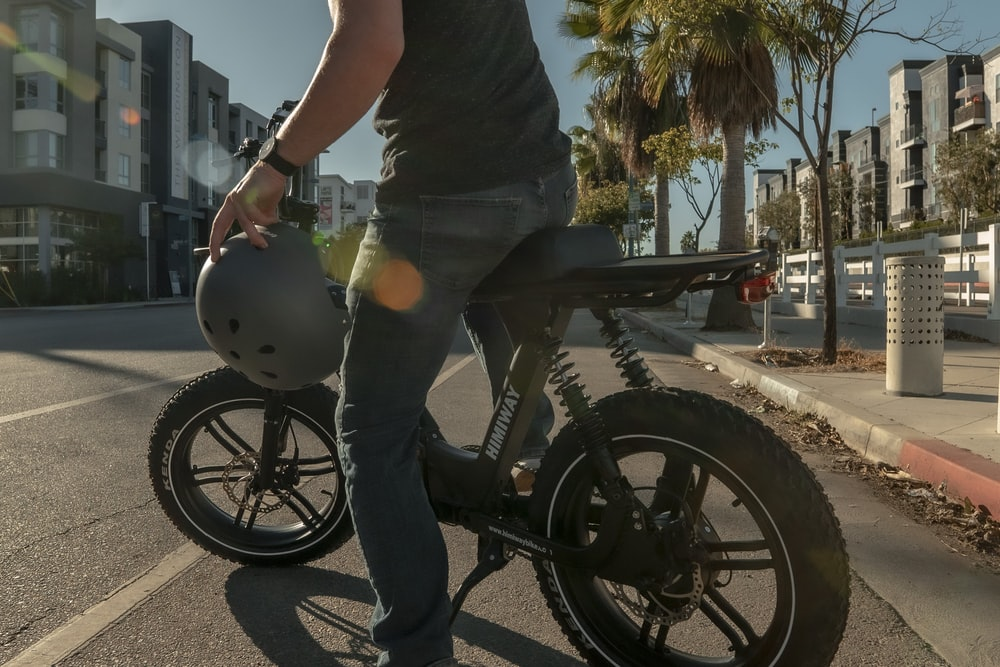 man in black t-shirt riding black motorcycle