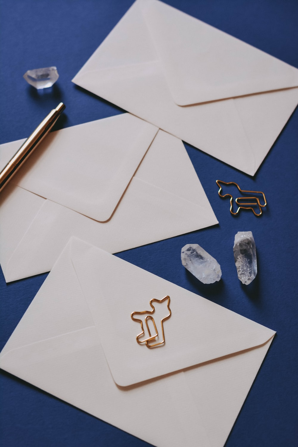 white printer paper with heart shaped and star shaped stones