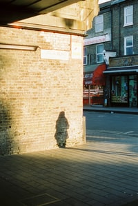brown brick building near pedestrian lane during daytime